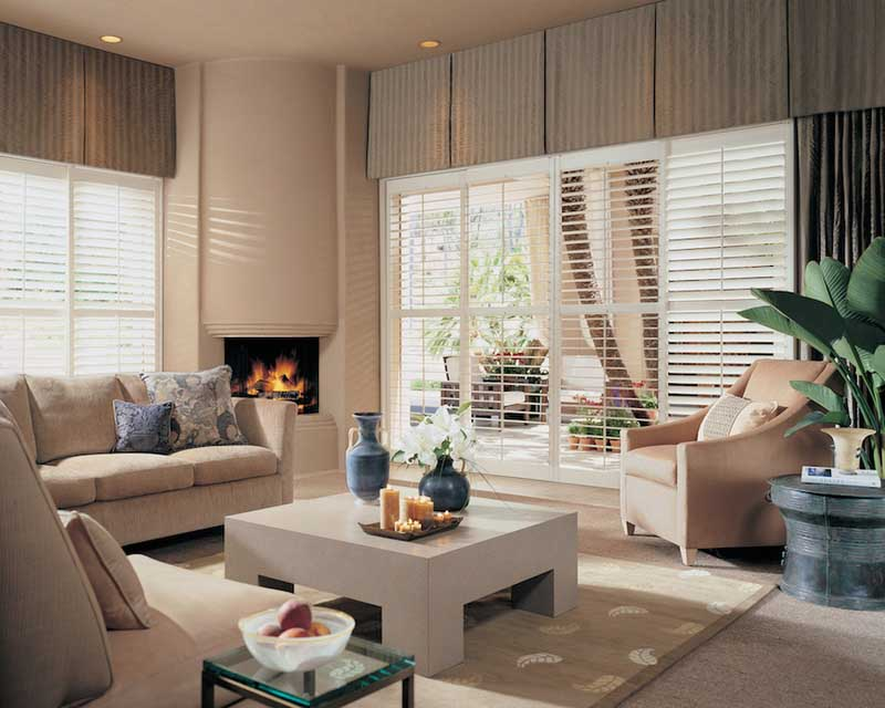 White plantation shutters on a large window